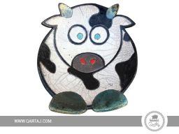 Handmade ceramic plate in a cow shape