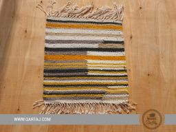 Small striped carpet handwoven by women artisans.