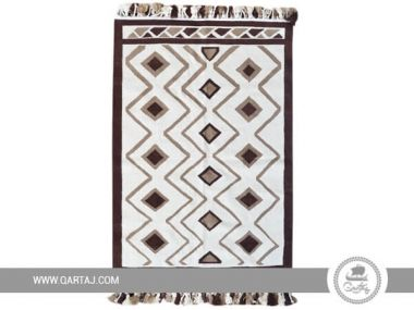 Double sided Sejnan carpet with geometric patterns.