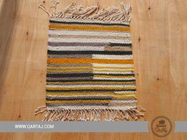 Small striped carpet handwoven by women artisans.