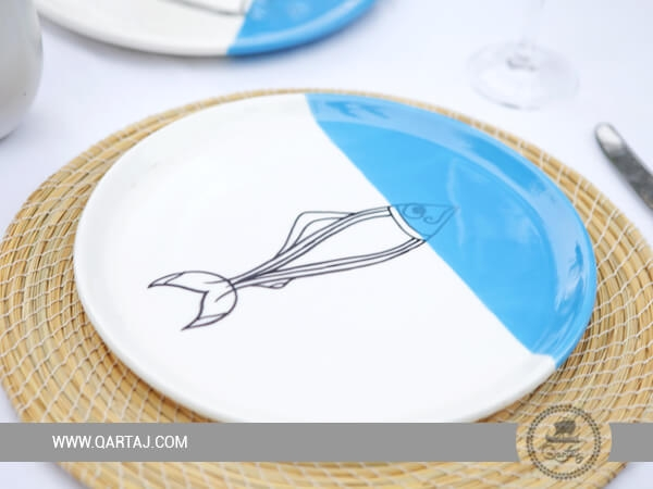 Blue and white painted sardines plates.