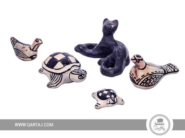 Set of Sejnan pottery statues: Black cat, 2 pigeons, 2 turtles